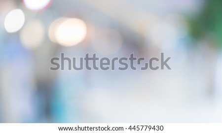 Blurred background :Customer shopping at department store with bokeh light.