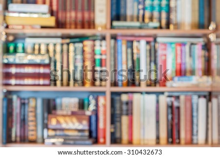 blurred background from many books in bookcase