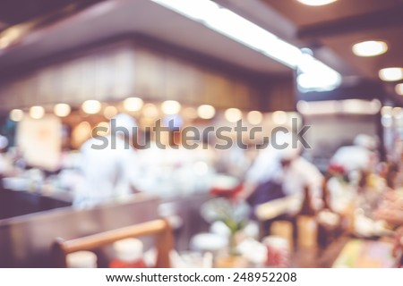 Blurred background : Groups of Chef cooking in the open kitchen,customer can see they cooking at food counter, cooking chef with light bokeh - stock photo