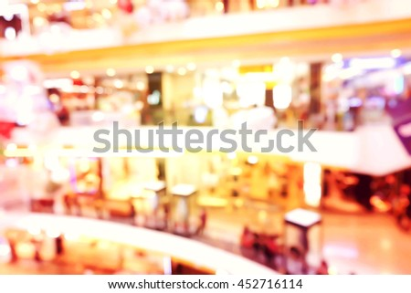 Blurred background image of people shopping in mall.