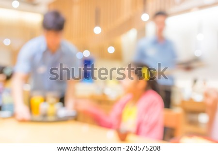 Blurred background image of young customer sit in restaurant - stock photo