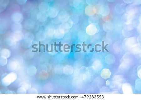 Blurred background in blue tones with bokeh lights