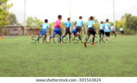 blurred background kid soccer player in academy - stock photo