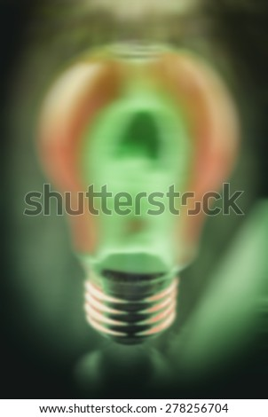 blurred background light bulb, pink and green - stock photo
