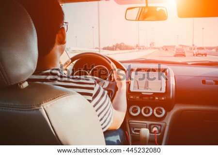 Blurred background ,Man driving car