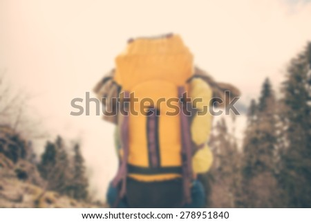 Blurred Background Man Traveler with backpack relaxing outdoor Lifestyle hiking concept trendy style - stock photo