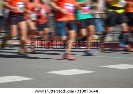 Blurred background: marathon running race, runners on road, sport, fitness and healthy lifestyle concept  - stock photo