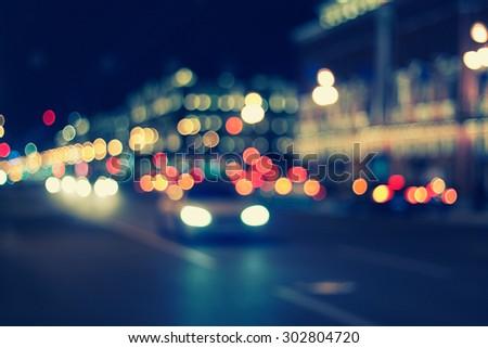 blurred background - night city life, retro style photography - stock photo