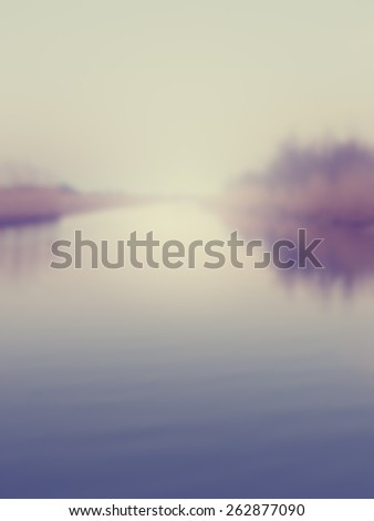 Blurred background of a river disappearing into the horizon. Designed to work with text overlays including the text colour white. Artistic intent with filters and desaturation.  - stock photo
