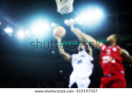 Blurred background of basketball players in court