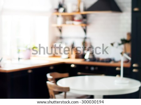 Blurred Background of Black and White Home Kitchen with Light Bokeh - stock photo