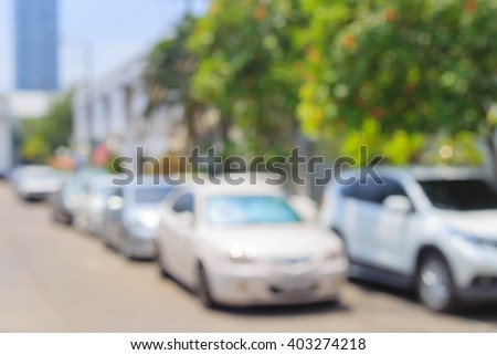 Blurred background of car parking at the office - stock photo