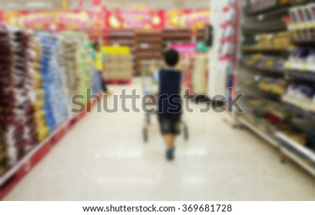 Blurred background of children shopping at supermarket.