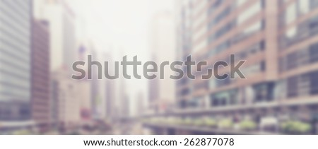 Blurred background of city skyscrapers. Designed to work with text overlays. Artistic intent with filters and desaturation. View with perspective effect. Letterbox format - stock photo