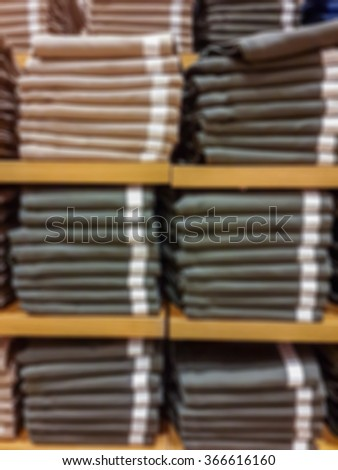 Blurred background of clothing racks for magazine and website design