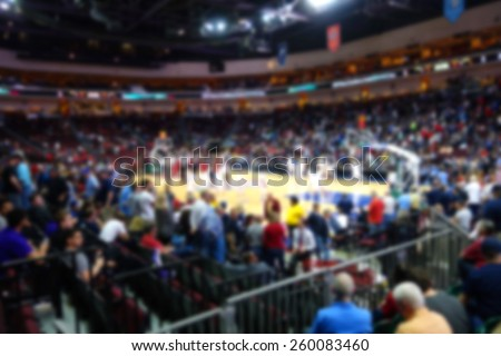 blurred background of college basketball crowd                               - stock photo