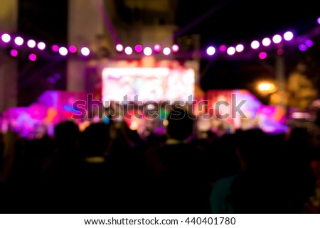Blurred background  of concert crowd in front of bright stage lights, Music life style - stock photo