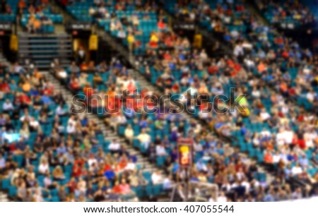blurred background of crowd at live event                              - stock photo
