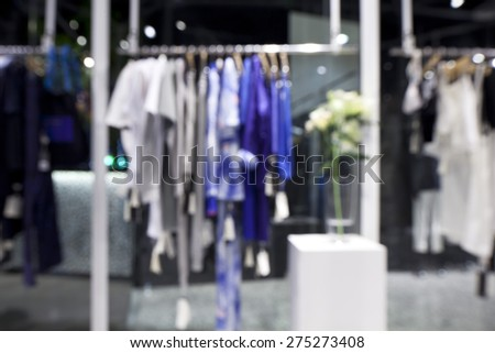 Blurred background of fashion shop in shopping mall - stock photo