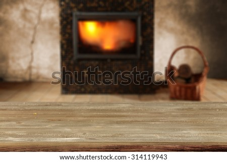 blurred background of fireplace and desk