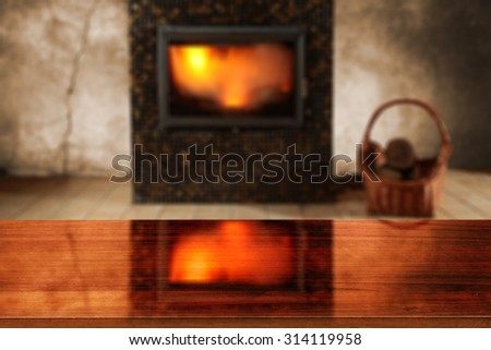 blurred background of fireplace and red desk