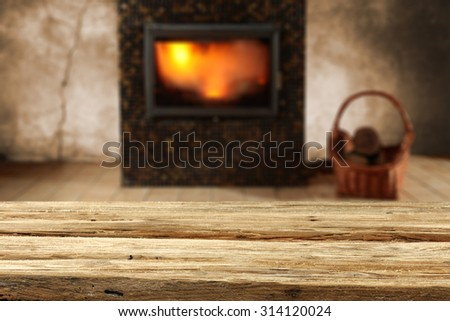 blurred background of fireplace and xmas desk space