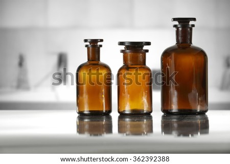 blurred background of gray interior with furniture and glasses empty bottles