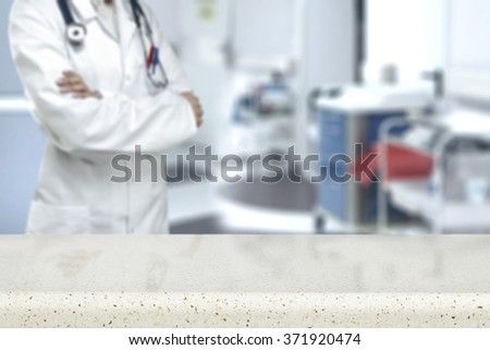 blurred background of hospital interior and white glasses space and space of doctor  - stock photo