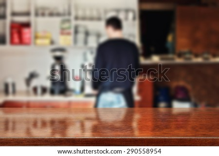 blurred background of interior in bar with barista and glasses brown top  - stock photo