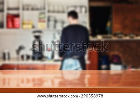blurred background of interior in bar with barista and red top place  - stock photo