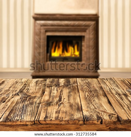 blurred background of interior with fireplace and shabby table place and wooden table