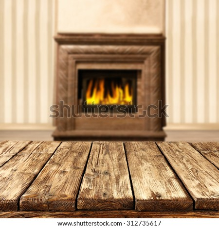 blurred background of interior with fireplace and table