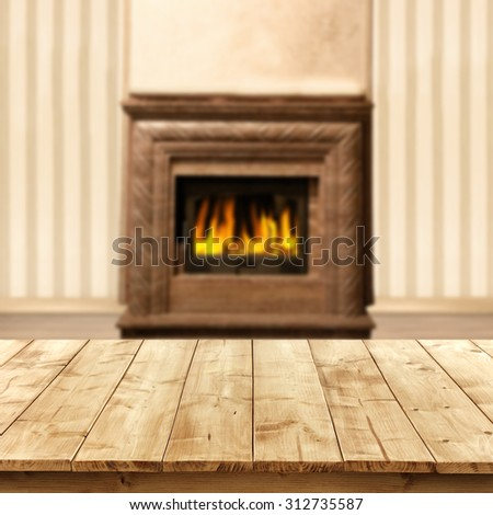blurred background of interior with fireplace and wooden yellow table