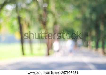 Blurred background of people activities in park with bokeh, spring and summer season - stock photo
