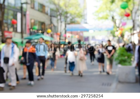 Blurred background of people shopping at street market. - stock photo