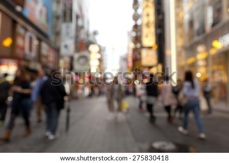 Blurred background of people shopping on the street,Osaka,Japan. - stock photo