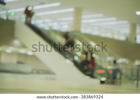 Blurred background of People walking in the airport,Airline passengers in the airport,passengers rushing at big city station. with retro filter effect,vintage color, - stock photo