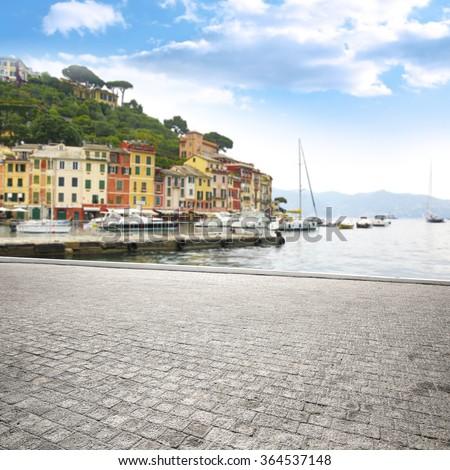 blurred background of Portofino port and gray terrace space  - stock photo