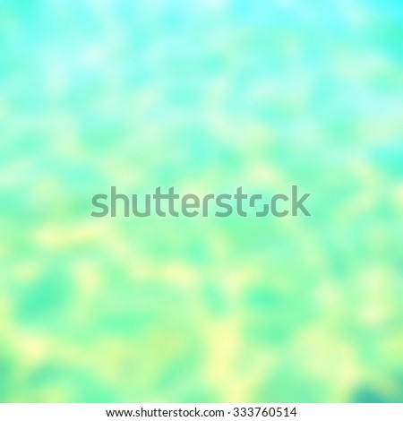 Blurred background of rippled water surface in cyan turquoise blue color tone.Faded retro image.  - stock photo