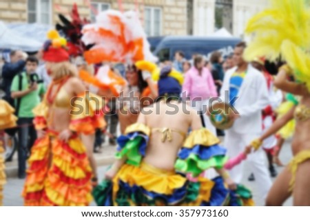 Blurred background of Samba dancers during carnival parade - stock photo