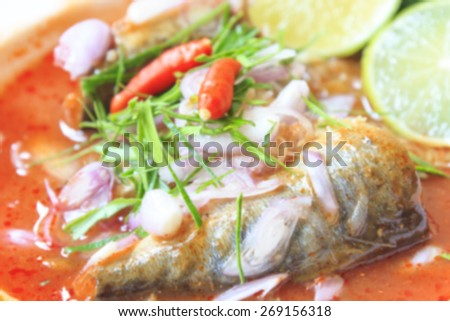 Blurred background of Sardines fish in tomato sauce, canned fish