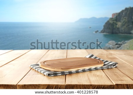 blurred background of sea and brown old desk top place  - stock photo