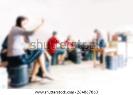 blurred background of sitting people in coffee cafe - stock photo