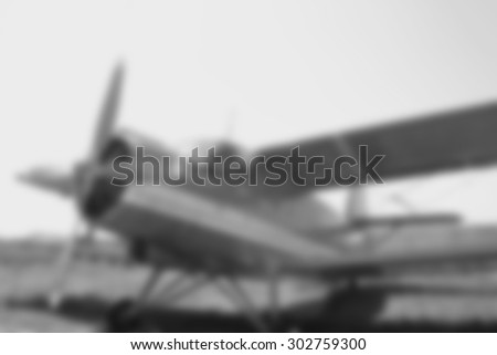 Blurred background of small red plane at sunny day - stock photo