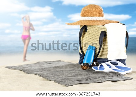 blurred background of summer coast and woman in pink bikini with sunny day on beach