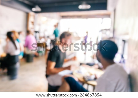blurred background of talking people in coffee cafe - stock photo