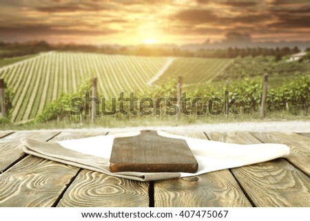 blurred background of vineyard and desk of brown color and summer time