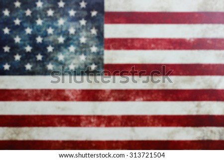 Blurred background of vintage American flag on canvas - stock photo