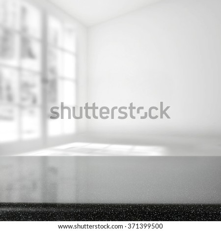 blurred background of window and black glasses table  - stock photo