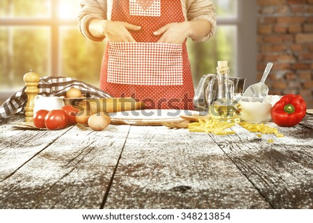 blurred background of window in kitchen and wooden table of flour and free space on desk  - stock photo